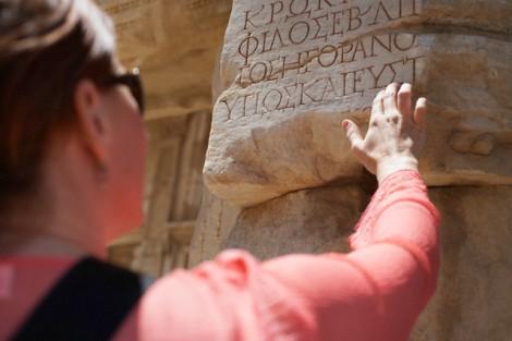 Woman Examining an Ancient Ruin