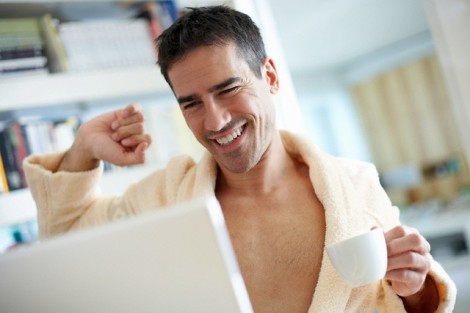 Man Wearing Bathrobe Using Laptop Computer